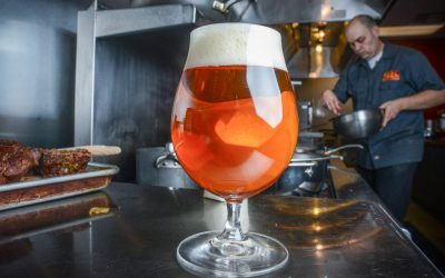 Cooking in a kitchen with a beer