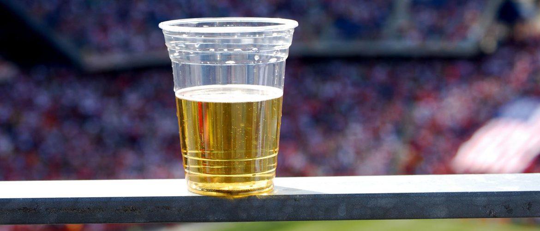 blond beer in plastic cup